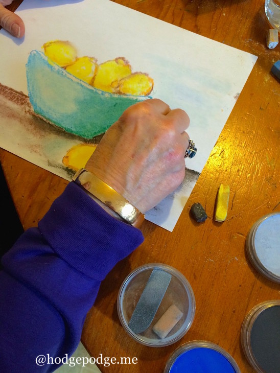 Nana painting lemons in chalk pastel