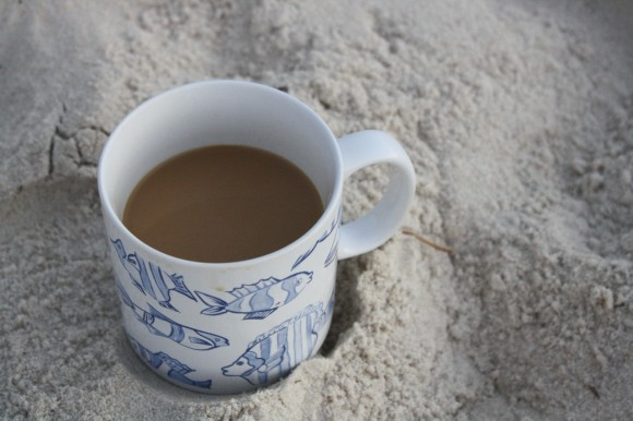 Coffee mug on beach
